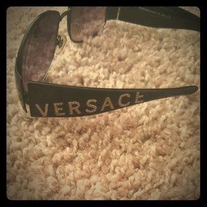 A pair of Versace unisex-adult sunglasses